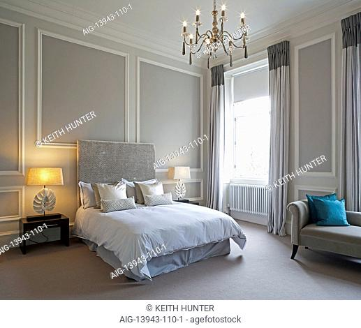 Double bed in traditional bedroom, Devonshire Terrace, Glasgow, Scotland, UK