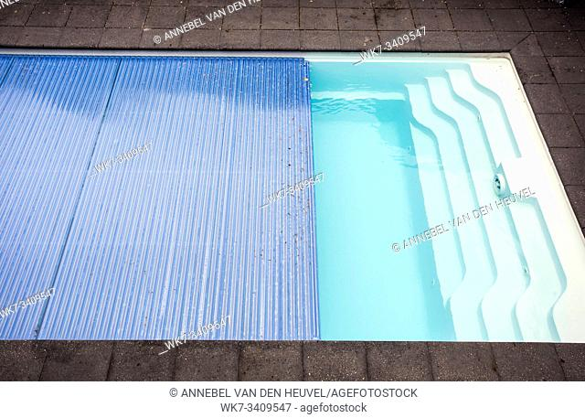 Swimming pool cover detail for protection and heat the water, pool roller-shutter covers close-up