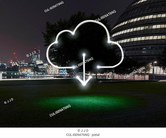 Glowing cloud symbol with download arrow in city at night