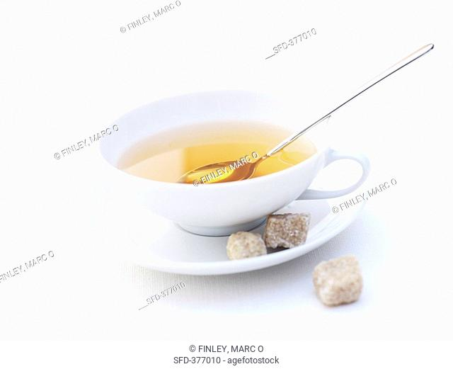 A cup of tea with brown sugar