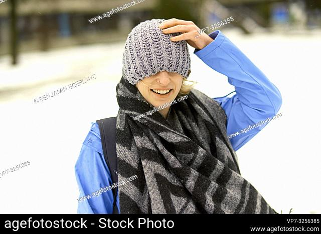 woman wrapped in winter clothes, in Munich, Germany