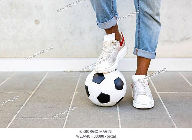 Man's feet with soccer ball