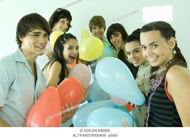 Group of young friends with balloons