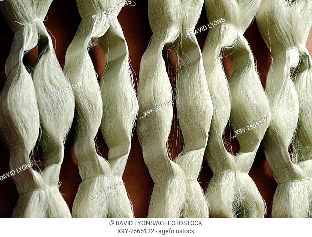 Hanks skeins of silk thread fibre yarn used in manufacture of quality Turkish carpet. Cankurtaran Carpet Centre, Denizli, Turkey