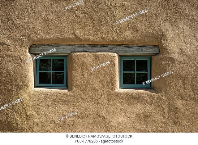 Pair of small square windows on adobe house, Santa Fe, New Mexico, USA