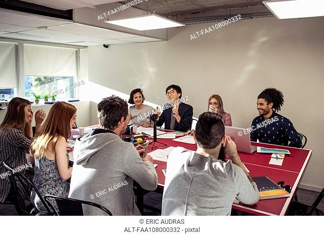 Colleagues meeting in casual office