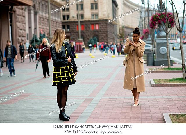 Natasha Shevchuk and blogger Sasha Zayats walking outside the Opening Ceremony during Mercedes Benz Kiev Fashion Days - Aug 30
