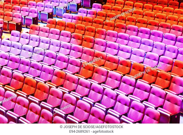Rows of empty seats in a performance auditorium