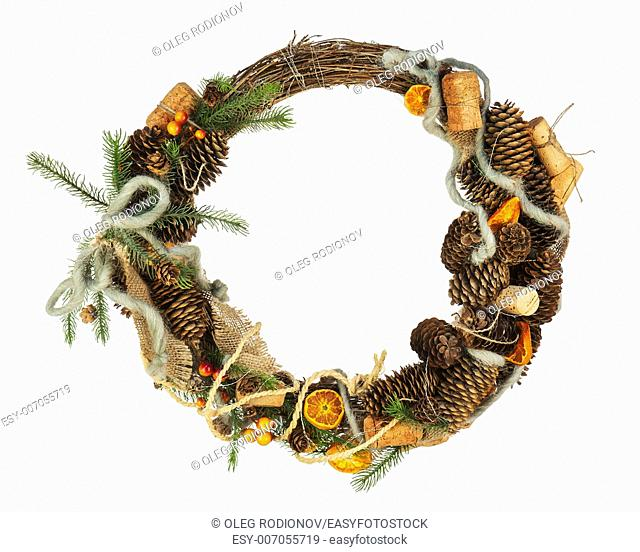 Green Christmas Wreath with Decorations Isolated on White Background. Closeup