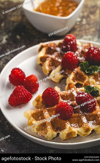 Waffle with cream raspberries and chocolate strawberries. Homemade