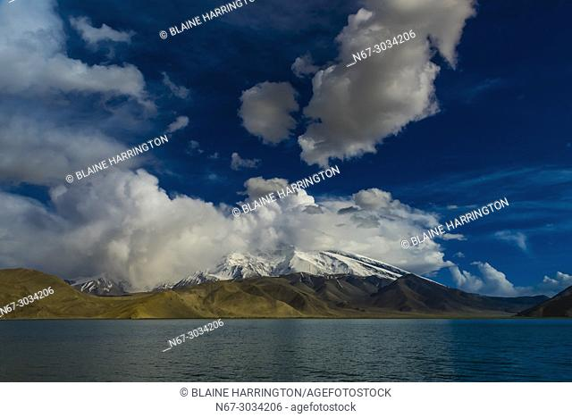Lake Karakul (11,811 feet) is the highest lake of the Pamir plateau, near the junction of the Pamir, Tian Shan and Kunlun mountain ranges