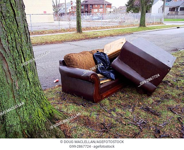 Furniture dumped by the roadside waiting to be picked up for garbage collection