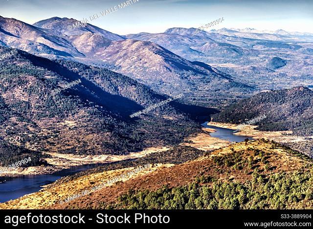 Burguillo reservoir from Merina hill and Sierra de Gredos on the background. Avila. Spain. Europe