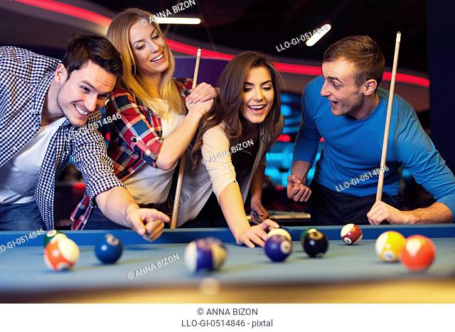 Group of young friends playing billiard. Rzeszow, Poland