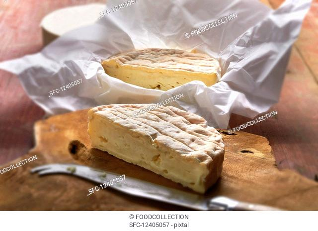 French soft cheese on a wooden board