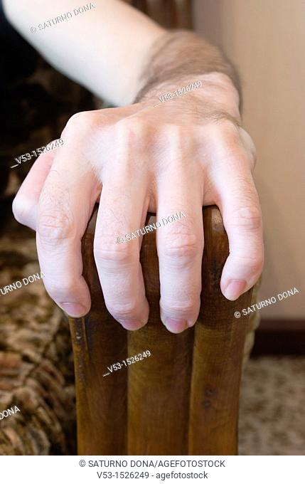 Hand grabbing armchair