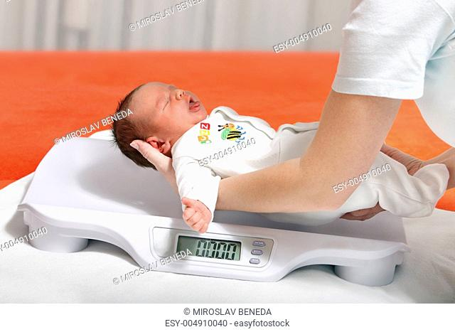 baby boy on weight scale
