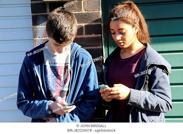 Teenagers using mobile phones