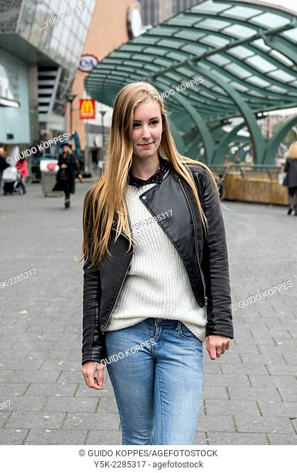 Rotterdam, Netherlands. Young, blond teenage girl in the streets of down town Rotterdam