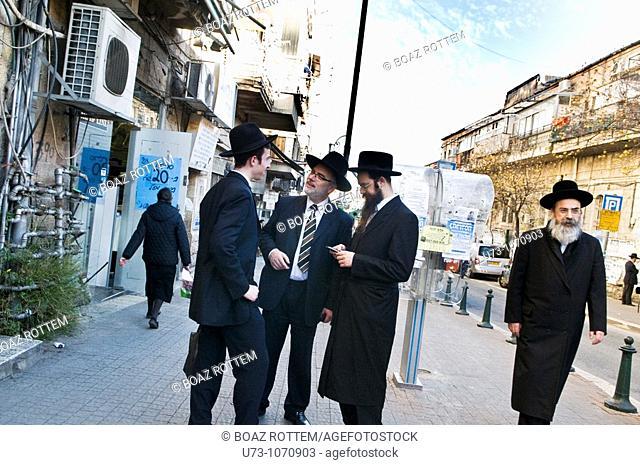 exchange of ideas in the middle of Mea Shearim neighborhood,Jerusalem