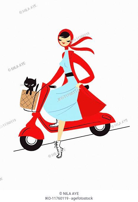 Beautiful woman on motor scooter