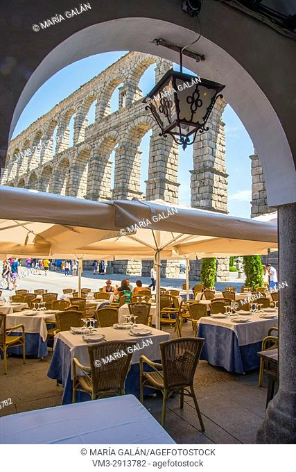 Terrace of Casa Candido restaurant and Roman aqueduct. Segovia, Spain