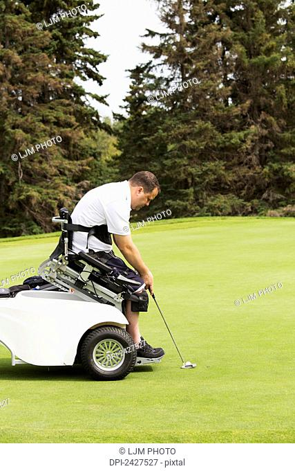 Disabled golfer in a tournament using high tech mobility aid; Edmonton, Alberta, Canada