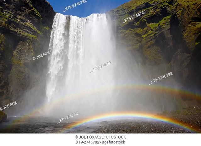 double rainbow at skogafoss waterfall in iceland