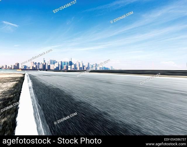 blurry empty asphalt road with cityscape of hangzhou in blue sky