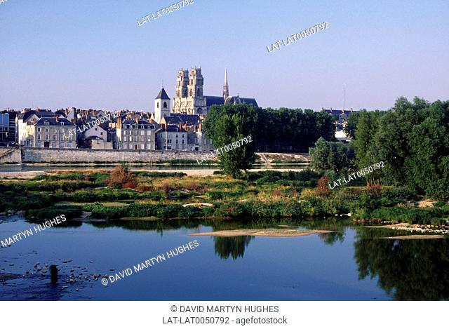 View of city over River Loire. Trees. Reflections. Loiret