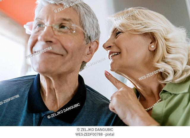 Senior woman talking to husband with hearing aid