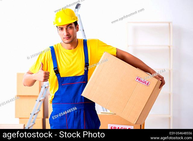 Young professional mover doing home relocation