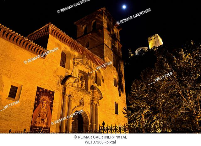 Church of Saint Peter and Paul at night with Alcazaba towers and moon in Granada