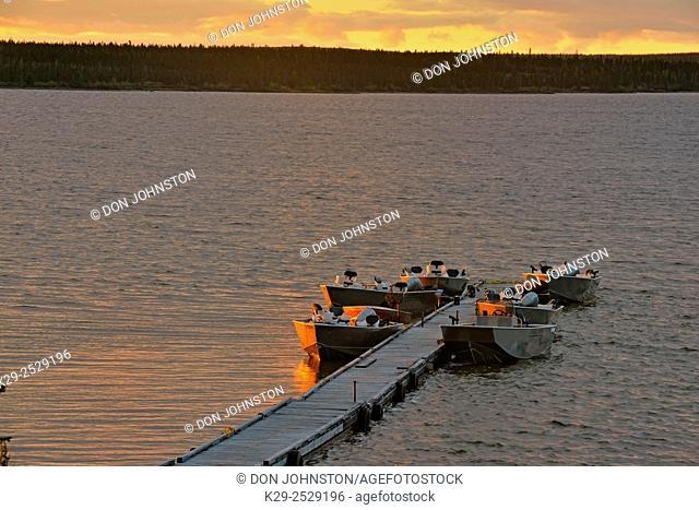 Fishing boats moored at pier on Ennadai Lake, Arctic Haven Lodge, Nunavut, Canada