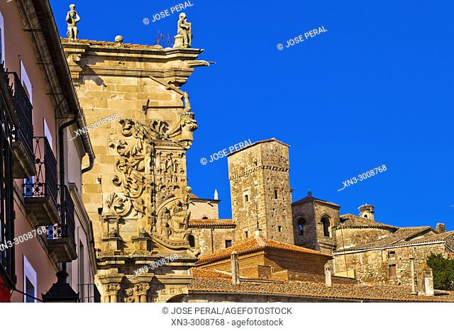 At left Palace of the Conquest, Palacio de la Conquista, At right tower of Luis Chaves el Viejo and church of Santiago from Plaza Mayor, Main Square, Trujillo