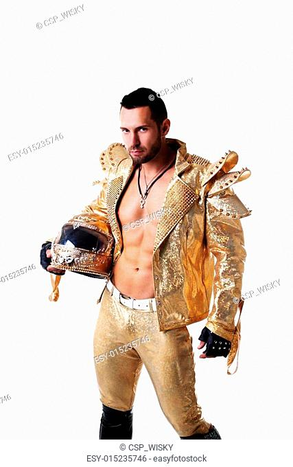 Attractive man posing in shiny suit for dance