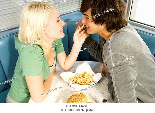 Teenage couple in a diner