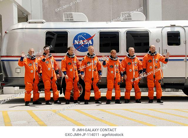 After suiting up, the STS-127 crew members pause alongside the Astrovan to wave farewell to onlookers before heading for launch pad 39A for the launch of Space...