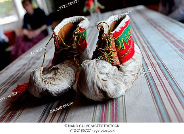 Traditional furry Sámi handmade shoes. Inside the home of Tuula Airamo, a Sámi descendant, and Reindeer farmer, by Muttus Lake