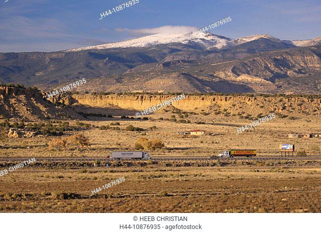Interstate I-40 and snow covered Mountains, San Fidel, New Mexico, USA