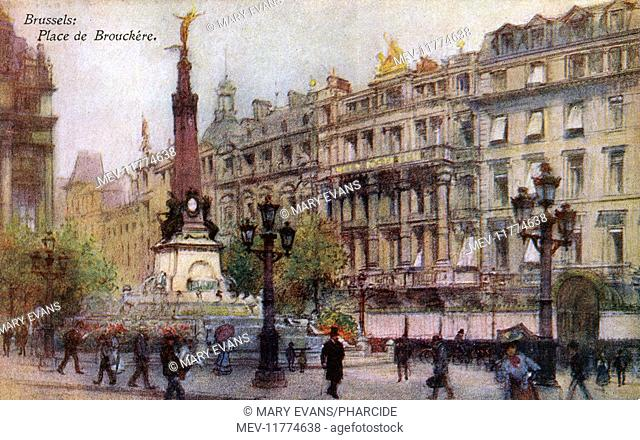 Place de la Brouckere, Brussels, Belgium, with the Anspach Monument and fountain on the left, and the Hotel Metropole on the right