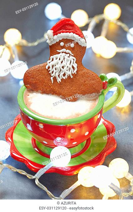 Gingerbread Santa man cookie in a hot cup of cappuccino