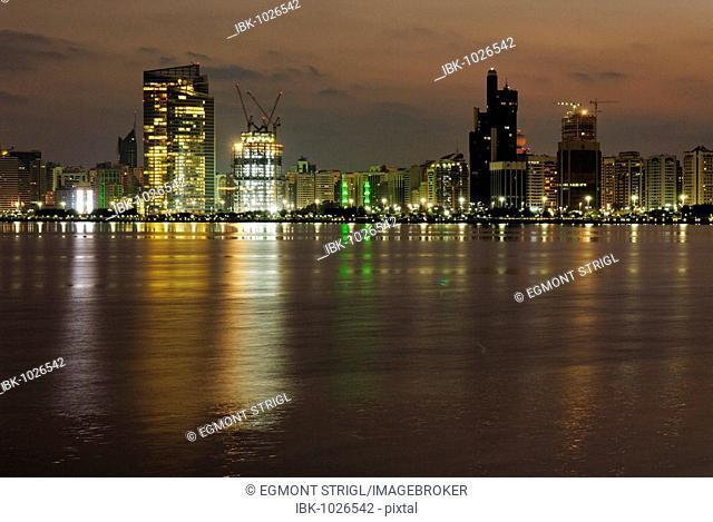 Abu Dhabi skyline at dusk, Emirate of Abu Dhabi, United Arab Emirates, Middle East