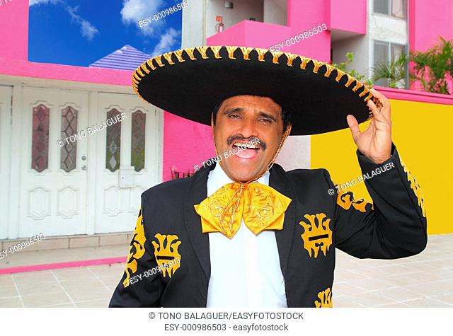 Charro mariachi portrait singing shout in mexican houses background