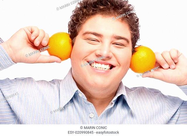 Chubby boy and orange