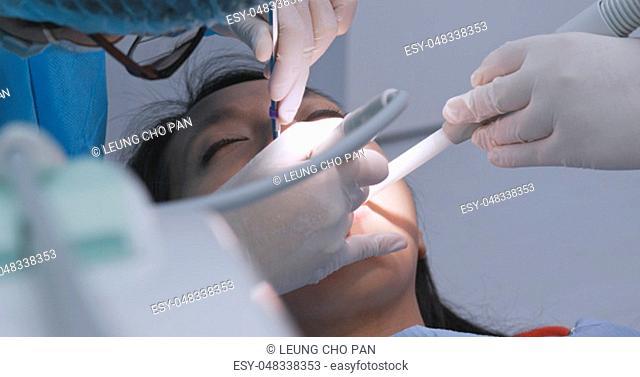 Patient undergo dental treatment in dental clinic