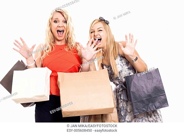 Two crazy blond girls shopping, isolated on white background