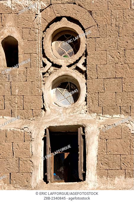 Small Round Stained Glass Windows On The Front Of A Typical House, Sanaa, Yemen