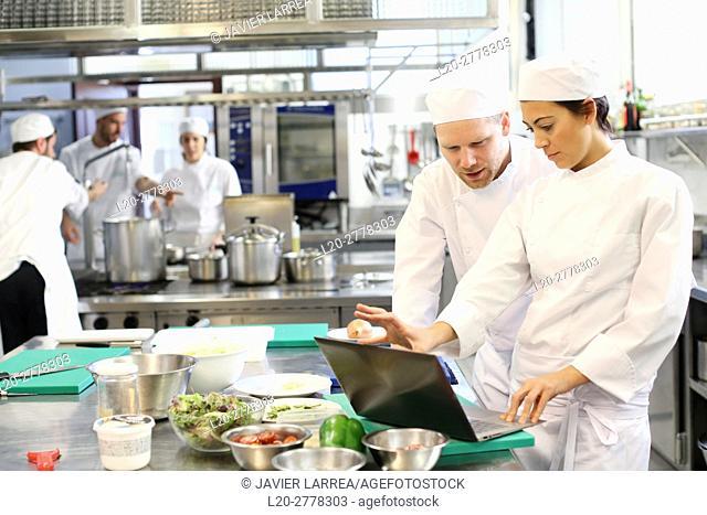 Chef with laptop computer, Cook in cooking school, Cuisine School, Donostia, San Sebastian, Gipuzkoa, Basque Country, Spain, Europe