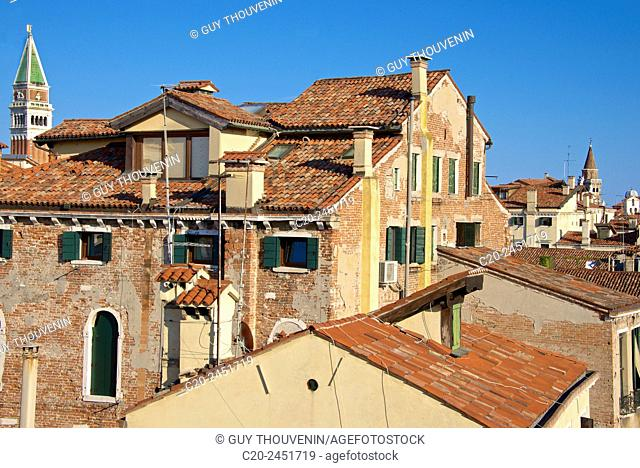 TV aerials, roofs and chimneys , San Marco Campanile in the background, Venice, Venetia, Italy